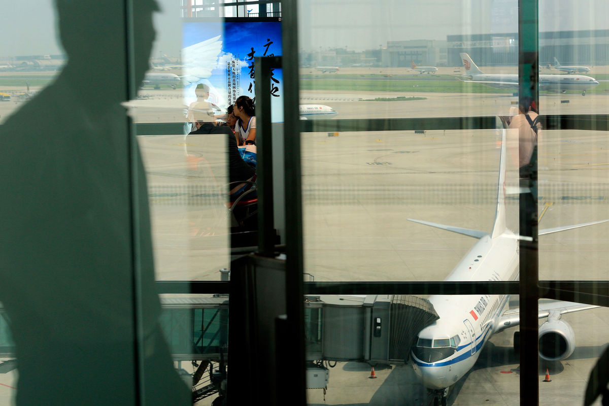 An Air China jet on the tarmac at Beijing Capital International Airport. Photographer: Nelson Ching/Bloomberg
